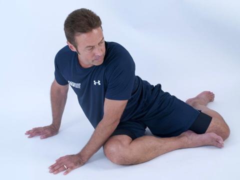 forward position of dynamic back rotation stretch