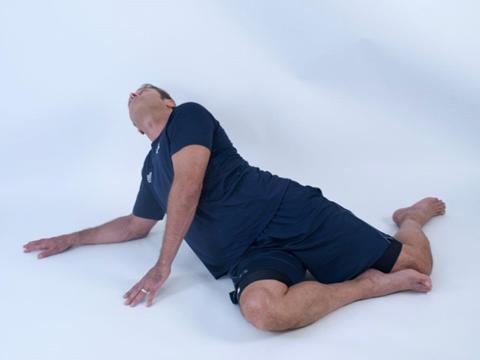 man doing a hip flexor stretch