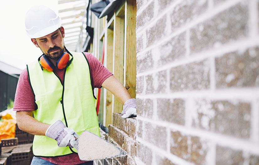 masonry worker doing brick work