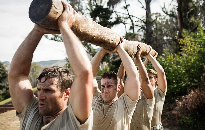 marines doing a log carry exercise