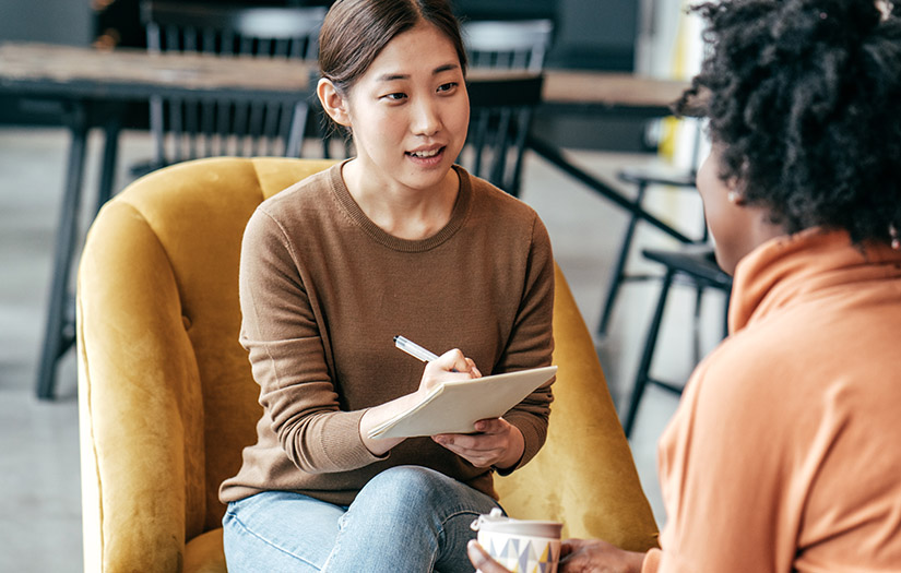 a woman practicing motivational interviewing with a client