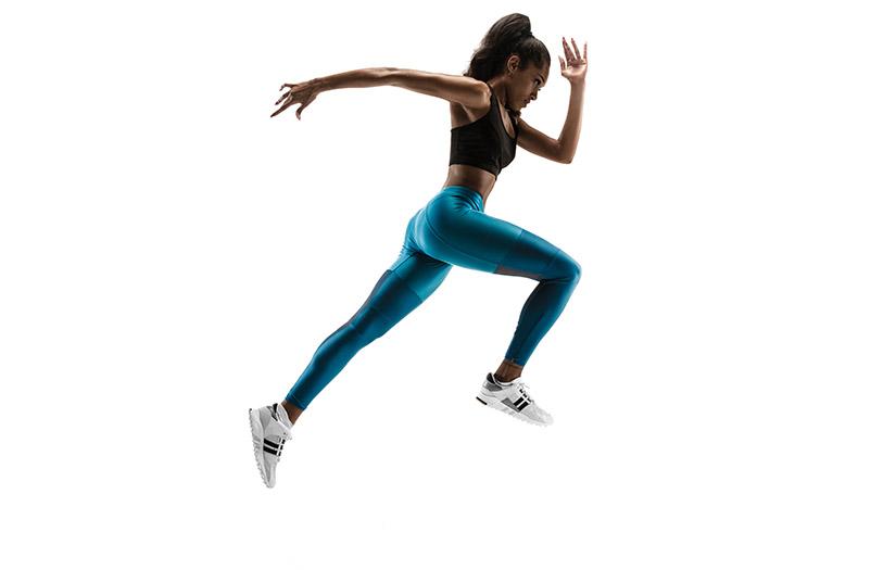a woman doing a sprint