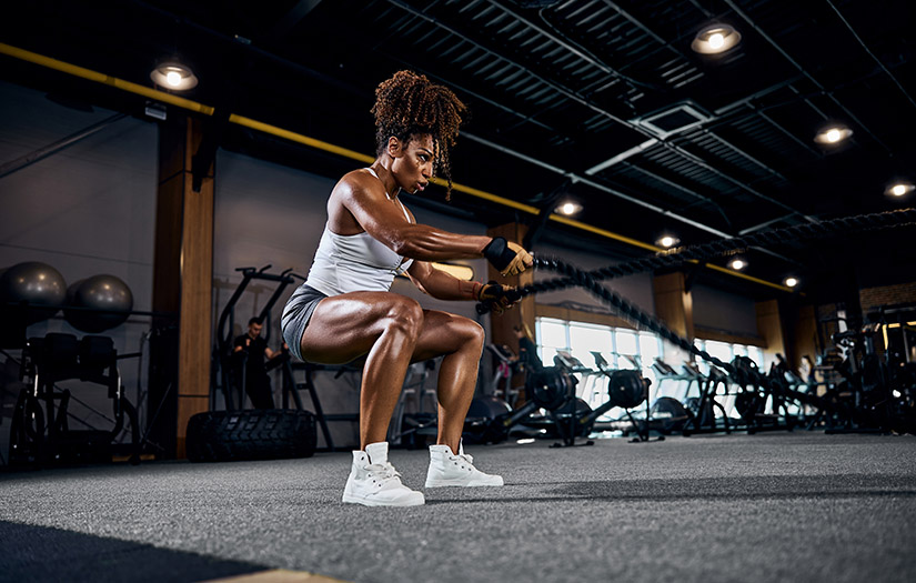 a woman doing battle ropes training