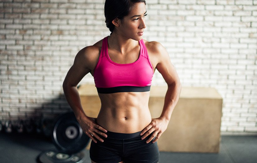 a woman with six pack abs