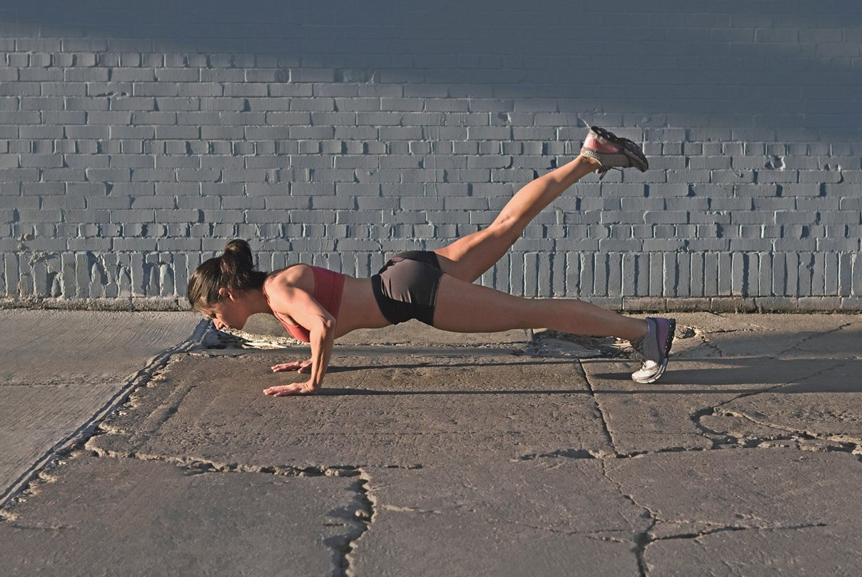 Woman doing a pushup outdoors