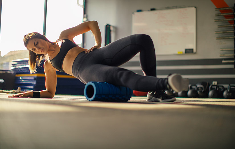 a woman doing phase 1 exercise with foam roller
