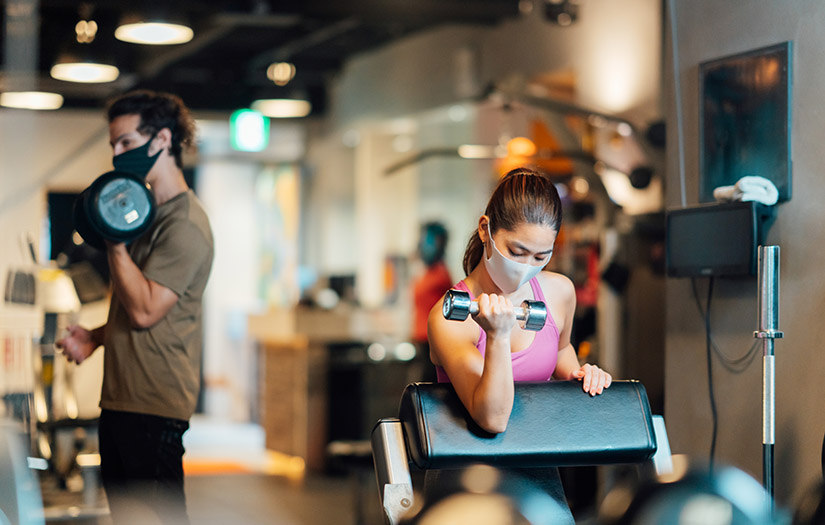 two fitness enthusiasts working out after covid